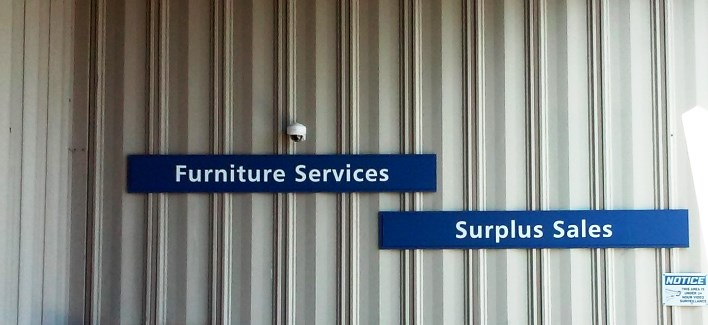 Furniture Services and Surplus Sales signs