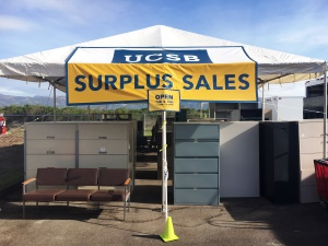 Surplus Sales sign on tent