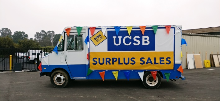 UCSB Surplus Sales banner on truck